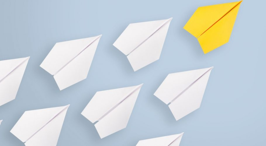 leadership-concepts-with-yellow-paper-airplane-leading-among-white-picture-id1133438274